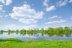 Sunny spring landscape water river blue sky clouds Stock Photo