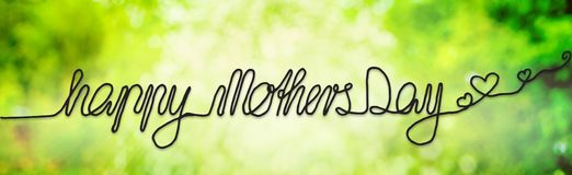 Sunny Spring Meadow, Daisy, Calligraphy Happy Mothers Day stock photography