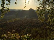Sunny spring sunrise in a beautiful valley of Saxony Switzerland park. Sandstone rocks Stock Image