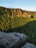 Sunny spring sunrise in a beautiful valley of Saxony Switzerland park. Sandstone rocks Royalty Free Stock Photography