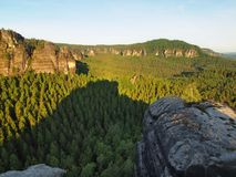 Sunny spring sunrise in a beautiful valley of Saxony Switzerland park. Sandstone rocks Royalty Free Stock Photos