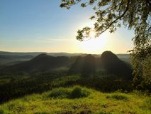 Sunny spring sunrise in a beautiful valley of Saxony Switzerland park. Sandstone rocks Stock Photography