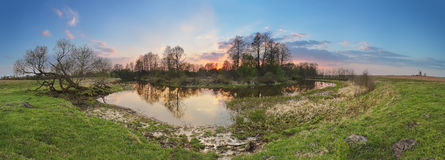 Sunny spring sunset landscape. River in a forest Royalty Free Stock Photos