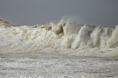 Stormy breaking waves stock images