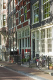 Sunny street in Amsterdam Royalty Free Stock Image