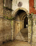 Sunny street corner. With a gate and stairs Royalty Free Stock Photos