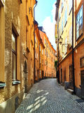 Sunny street in the old center of Stockholm Royalty Free Stock Image