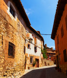 Sunny street of old spanish town Stock Images