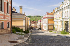 Sunny street with paving blocks Stock Image