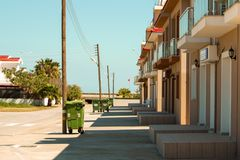 Sunny street with small modern houses. Beautiful sunny street with small modern houses near the sea. Northern Cyprus, Turkey Royalty Free Stock Photos