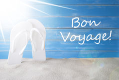 Sunny Summer Background, Bon Voyage Means Good Trip. French Text Bon Voyage Means Good Trip. Sunny Summer Greeting Card With Sand And Flip Flops. Blue Vintage Royalty Free Stock Photography