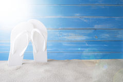 Sunny Summer Background With Copy Space For Advertisement. Copy Space For Advertisement Or Free Text. Sunny Summer Greeting Card With Sand And Flip Flop. Blue Stock Photos