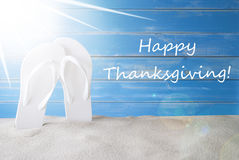 Sunny Summer Background, Text Happy Thanksgiving. English Text Happy Thanksgiving. Sunny Summer Greeting Card With Sand And Flip Flops. Blue Vintage And Shabby royalty free stock photos