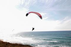 A paraglider on the background of beautiful see and blue sky stock photo