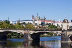 Sunny summer day in the center of Prague. City cenre with a view to the Prague castle over the Vltava river Stock Photos