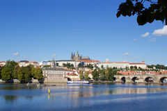 Sunny summer day in the center of Prague. City cenre with a view to the Prague castle over the Vltava river Royalty Free Stock Image