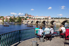 Sunny summer day in the center of Prague. City cenre with a view to the Prague castle over the Vltava river Royalty Free Stock Photo
