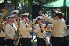 Sunny summer day in the city Park. brass band of sailors played in the city Park. Stock Photo