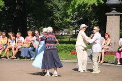 Sunny summer day in the city Park. The citizens and guests of the city walk, dance and relax on the walk in Petrovsky Park. Stock Photos