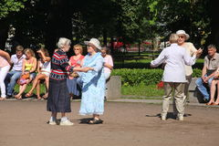 Sunny summer day in the city Park. The citizens and guests of the city walk, dance and relax on the walk in Petrovsky Park. Royalty Free Stock Photography