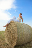 Sunny summer day on corn field. Summer enjoying woman relaxing on corn field behind blue sky Royalty Free Stock Images
