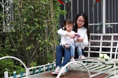 Happy family parental activity mother daughter hand in hand play and have fun outdoor in summer park child parent love girl. In sunny summer day, partents play stock images