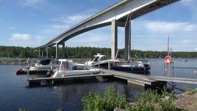 Sunny summer day at the road bridge Puumala. Finland stock video footage