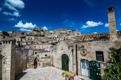 Sunny summer day street view of Matera, Italy. MATERA, ITALY - AUGUST 27, 2018: Summer day scenery street view of the amazing ancient town of the Sassi with stock image