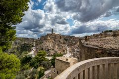 Sunny summer day street view of Matera, Italy. MATERA, ITALY - AUGUST 27, 2018: Summer day scenery street view of the amazing ancient town of the Sassi with stock images