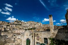 Sunny summer day street view of Matera, Italy. MATERA, ITALY - AUGUST 27, 2018: Summer day scenery street view of the amazing ancient town of the Sassi with royalty free stock photo