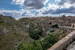 Sunny summer day street view of Matera, Italy. MATERA, ITALY - AUGUST 27, 2018: Summer day scenery street view of the amazing ancient town of the Sassi with royalty free stock images