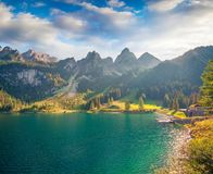 Sunny summer morning on the Gosau Lake Vorderer Gosausee. Colorful outdoor scene in Upper Austrian Alps, Salzkammergut region, Austria, Europe. Artistic style Royalty Free Stock Image