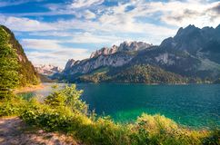 Sunny summer morning on the Gosau Lake Vorderer Gosausee with. View of Hoher Dachstein and Gosau glacier. Colorful outdoor scene in Upper Austrian Alps Stock Photography