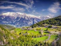 Sunny summer morning in Italian Alps. Stock Photos