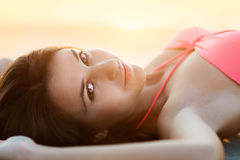 Sunny summer portrait of a beautiful smiling young woman Stock Image