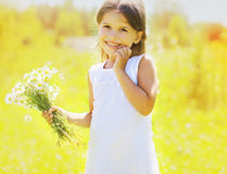Sunny summer portrait of charming cute little girl. With daisies Royalty Free Stock Photos