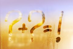 Summer rain, on the sweaty glass question mark, exclamation, and the sign is equal royalty free stock photography