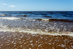 Sunny summer scene of Baltic sea with beautiful seaside with wav. Es Royalty Free Stock Images