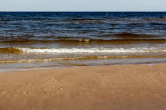 Sunny summer scene of Baltic sea with beautiful seaside with wav. Es Royalty Free Stock Photo