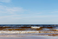 Sunny summer scene of Baltic sea with beautiful seaside with wav. Es Stock Photography
