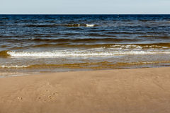 Sunny summer scene of Baltic sea with beautiful seaside with wav. Es Royalty Free Stock Photos