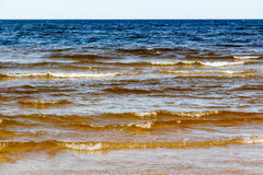 Sunny summer scene of Baltic sea with beautiful seaside with wav. Es Stock Photo