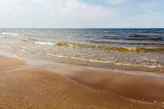 Sunny summer scene of Baltic sea with beautiful seaside with wav. Es Royalty Free Stock Image