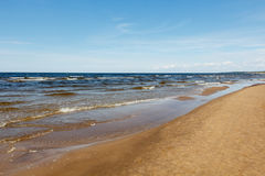 Sunny summer scene of Baltic sea with beautiful seaside with wav. Es Royalty Free Stock Photography
