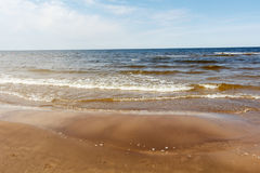 Sunny summer scene of Baltic sea with beautiful seaside with wav. Es Stock Photos