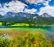 Sunny summer scene on the Hintersee lake in Austrian Alps. Royalty Free Stock Photography
