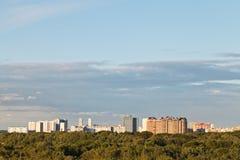 Sunny summer twilight over city Stock Photo
