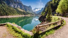 Sunny sunrise at Gosausee lake in Gosau, Alps, Austria, Europe. Sunny sunrise at Gosausee lake in Gosau, Alps, Austria Stock Photo