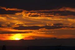 Sunny sunset. Black-orange sunny sunset in the summer Stock Image