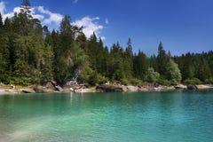 Sunny swiss lake, Switzerland. Sunny day in swiss mountains lake CAoma Stock Photography